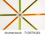 Small photo of pencils in arrange in color wheel colors on white background