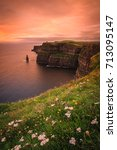 Small photo of Landscape of the Irish coast at sunset: Cliffs of Moher at Dusk - Clare, Ireland