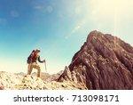 hiking scene in cordillera... | Shutterstock . vector #713098171