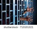 hands of prisoner in jail as... | Shutterstock . vector #713101321
