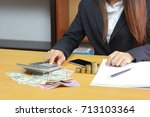 businesswoman using a... | Shutterstock . vector #713103364