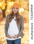 young pregnant woman in casual...   Shutterstock . vector #713109949