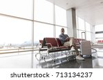 happy smiling passenger waiting ... | Shutterstock . vector #713134237