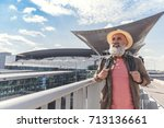 happy smiling elder tourist... | Shutterstock . vector #713136661
