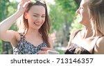 two teenage girls using mobile... | Shutterstock . vector #713146357