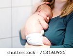 mother holding her newborn baby ...   Shutterstock . vector #713160925