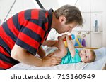 loving father changing diaper... | Shutterstock . vector #713160949
