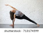 young woman practicing yoga ...   Shutterstock . vector #713174599