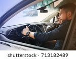 couple chooses the new car in... | Shutterstock . vector #713182489