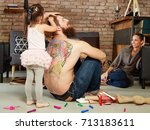 little girl playing with father ... | Shutterstock . vector #713183611