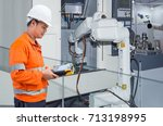 engineer programming automatic... | Shutterstock . vector #713198995