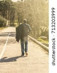 young man walking on a...   Shutterstock . vector #713203999