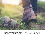 shoes man walking on a forest... | Shutterstock . vector #713225791