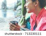 woman backpacker sitting inside ... | Shutterstock . vector #713230111
