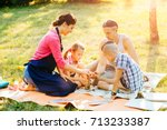 happy mother  father and two... | Shutterstock . vector #713233387