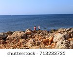 Small photo of rocky sea shore