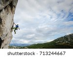 young male climber hanging by a ... | Shutterstock . vector #713244667