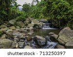 river and rock | Shutterstock . vector #713250397