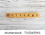 Small photo of CRITICAL word made with wooden blocks concept