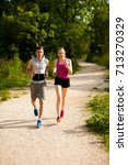 active young couple running in... | Shutterstock . vector #713270329
