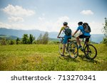 active young couple biking on a ... | Shutterstock . vector #713270341