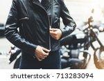 girl unfastens black leather... | Shutterstock . vector #713283094