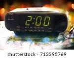 black digital alarm radio clock.... | Shutterstock . vector #713295769