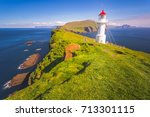 lighthouse  mykines island... | Shutterstock . vector #713301115