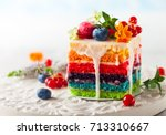 a slice of rainbow cake... | Shutterstock . vector #713310667