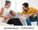 little girl at home with mum... | Shutterstock . vector #713314411
