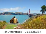 couple sitting on top of the... | Shutterstock . vector #713326384