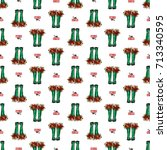 vector green polka dot wellies... | Shutterstock .eps vector #713340595