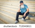 emotional senior man talking on ... | Shutterstock . vector #713343811