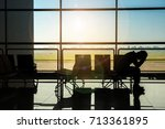 man in airport. airplane  view... | Shutterstock . vector #713361895
