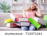 young woman with shopping bags... | Shutterstock . vector #713371261