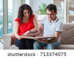young couple family expecting a ... | Shutterstock . vector #713374075