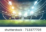 stadium in lights and flashes... | Shutterstock . vector #713377705