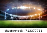 stadium in lights and flashes... | Shutterstock . vector #713377711