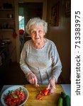 elderly woman preparing... | Shutterstock . vector #713383975