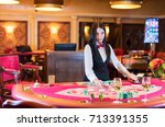 cute lady casino dealer at... | Shutterstock . vector #713391355