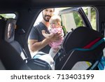 father putting his baby... | Shutterstock . vector #713403199