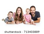 happy smiling family of four... | Shutterstock . vector #713403889