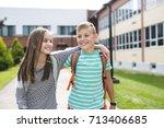 portrait of two school friends... | Shutterstock . vector #713406685