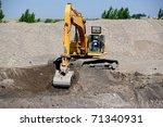 A Back Hoe Digging