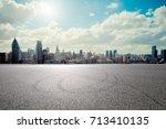 empty asphalt road with... | Shutterstock . vector #713410135