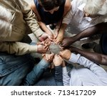 group of diverse hands holding... | Shutterstock . vector #713417209
