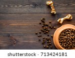 Stock photo bowl full and overflowing with dry pet dog food bits with toys on wooden background top view mock 713424181