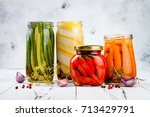 marinated pickles variety... | Shutterstock . vector #713429791