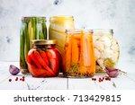marinated pickles variety... | Shutterstock . vector #713429815