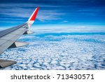 the plane on the clouds | Shutterstock . vector #713430571